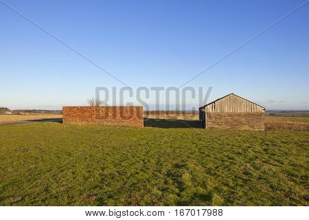 Barn And Brick Wall