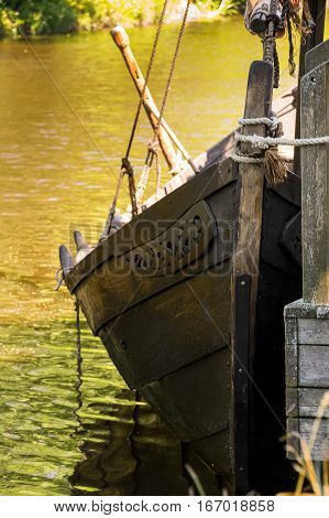 An Old Viking Ship In The Water At The Dock