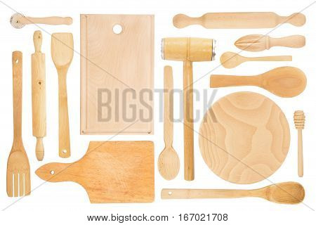 Set of the wooden kitchen utensils on white background