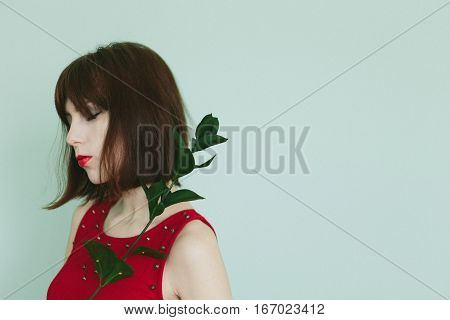 girl in red dress with green banch Add noise and filters.