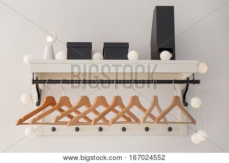 A closet with stylish lights and clothes hanger