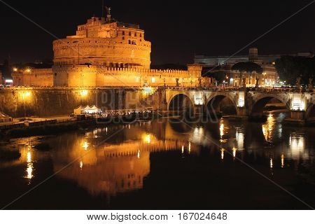Saint Angel Castle and the Angels bridge by night in Rome, Italy