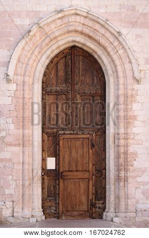 Entrance door of St. Claire Cathedral in Assisi, Italy