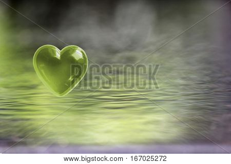 Green Heart with soft focus water reflections