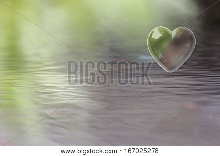Green Brown Heart with soft focus water reflections