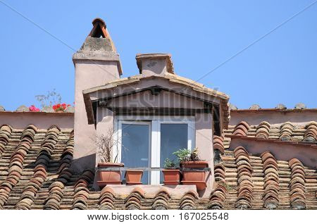 Mansard window in a old style roof