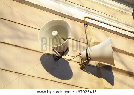 On the wall hang two of the horn to alert the townspeople.