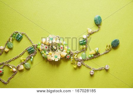 green beadwork necklace photo with empty copy space