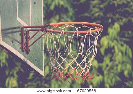 Basketball hoop make by wooden and ball in park process in vintage style