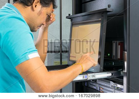 Asia Man Serious Working On Computer