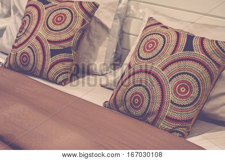 Pillow brown color on a bed in bedroom earth tones decoration process in vintage style
