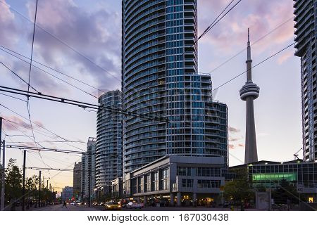 TORONTO,CANADA-AUGUST 2,2015:view of the CN tower in Toronto during a sunset from one of the central street of the city near the union station.
