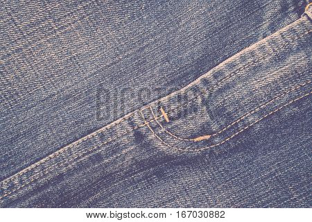 Detail of blue jeans crotch with yellow stitch process in vintage style