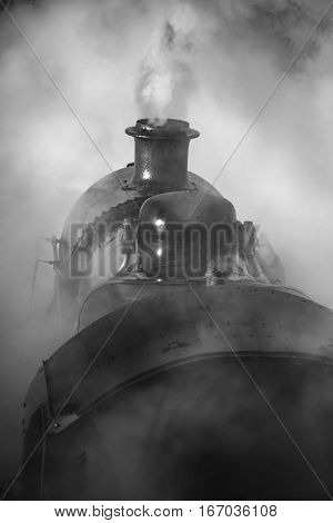 Restored Victorian Era Steam Train Engine With Full Steam In Black And White