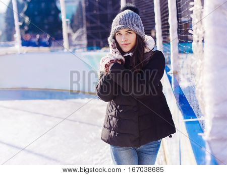 Beautiful Young Woman With Ice Skates To Go To The Rink