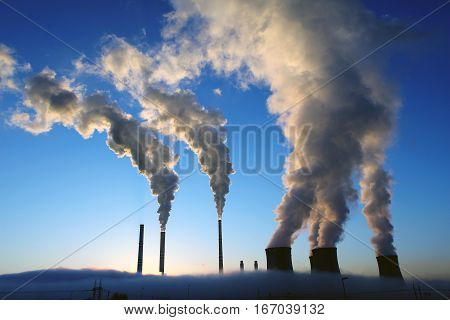 Coal power plant during a foggy morning