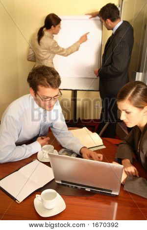Business Team Preparing A Proposal