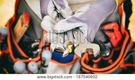 Hands Holding Set Of Spanners