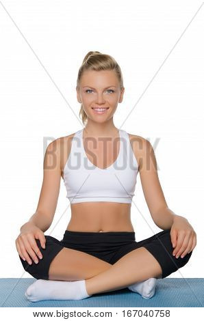 beautiful smiling woman doing yoga isolated on white