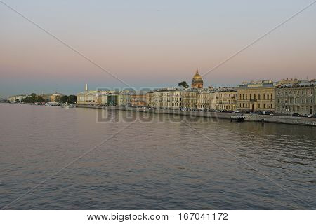 Views of the river Neva, English embankment, St. Isaac's Cathedral with Blagoveshenskaja bridge on a summer evening in St. Petersburg.