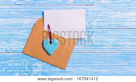 empty postcard love letter with envelope and blue turquoise heart