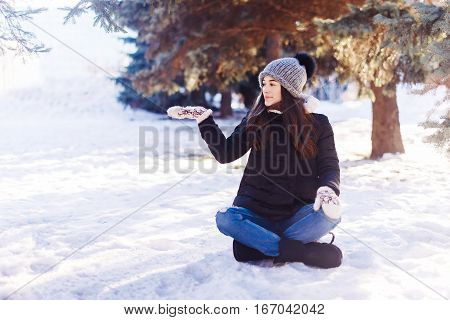 Young Woman Yoga Pose Outdoors In Winter. Showing Hand Gesture