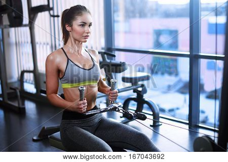 Athletic Young Woman Works Out On Training Apparatus In Gym Class