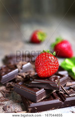 Stack Of Chocolate Slices With Fresh Ripe Strawberry.