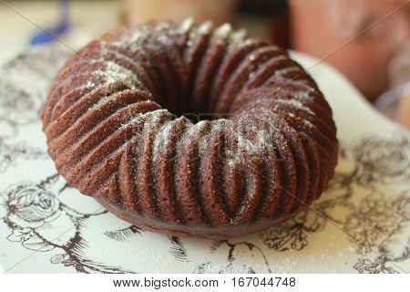 This is a pumpkin spice bundt cake on a platter on a counter