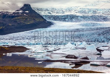 Glacier provides water Ice Lagoon Jokulsarlon. Vatnajokull, Iceland's largest glacier. Sunset lights up the glacier. The concept of extreme northern tourism