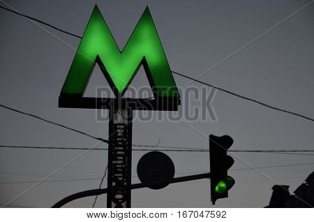Metro logo. Subway. Subway logo. Traffic light. Green color. City lights. Metropolis lights.