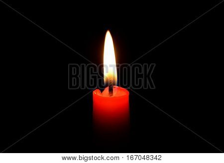 Burning candle. The candle burns. A candle flame. Red candle. Light candles.