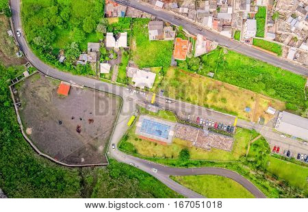 Aerial City View With Buildings And Parking Lots Of Banos De Agua Santa Tungurahua Province In The Daylight South America