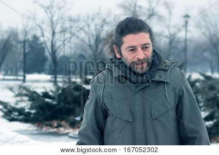 Worried middle aged man on a cold winter day