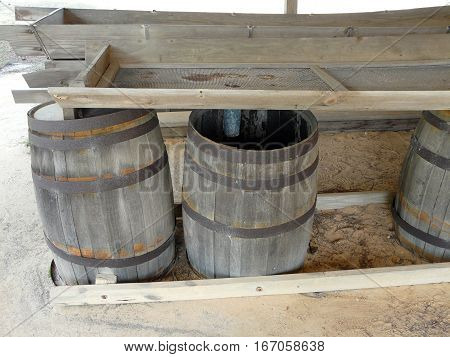 A still at St. Andrews State Park Panama City Florida displays the barrels used to separate turpentine from water when distilling resin from pines.