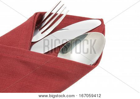 Fork And Knife On Red Napkin Isolated