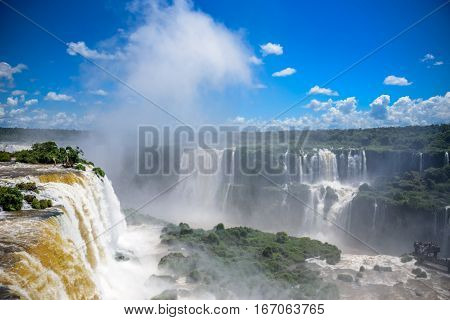Aerial view of Iguazu Falls one of the worlds largest and most impressive waterfalls with bouncing mass of mist in Iguacu National Park, UNESCO World Heritage Site, Foz de Iguacu, Parana State, Brazil