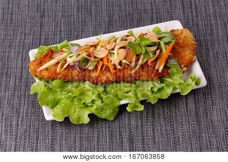 Spicy Deep-fried Dolly's Fish Salad With Roll Green Mango.