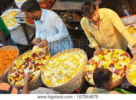 MUMBAI INDIA - JANUARY 11 2017: Mumbai Flower Market. The Dadar Flower Market opens at 4am is filled with vendors offering their wares to shop owners decorators and florists.