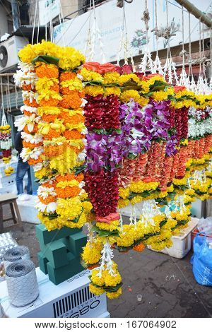 MUMBAI INDIA - JANUARY 11 2017: Garlands at the Mumbai Flower Market. The Flower Market opens at 4am is filled with vendors offering their wares to shop owners decorators and florists.