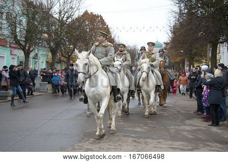 GATCHINA, RUSSIA - NOVEMBER 07, 2015: Squad of cavalry White army on a city street. Parade participants of the international military-historical festival