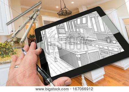 Hand of Architect on Computer Tablet Showing Drawing of Kitchen Photo Behind with Compass and Ruler.