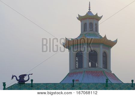 SAINT PETERSBURG, RUSSIA - NOVEMBER 30, 2014: Dome of the pagoda of the misty November day. A fragment of the complex