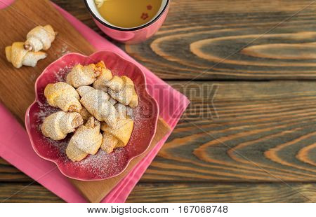 Delicious homemade cookies with jam on wooden background.
