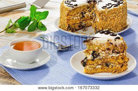 Portion Of Sponge Prune Cake Decorated With Shiny Chocolate Glaze