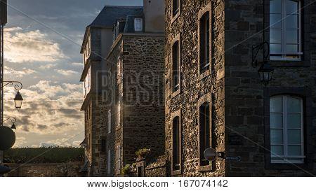 Grey stone facades in sunset light in Saint-Malo, Bretagne France