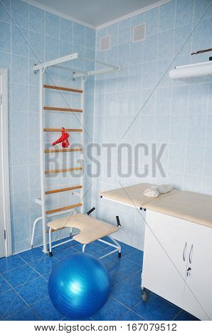 Delivery room with gymnastics wall bars and ball for active exercising woman preparing for childbirth