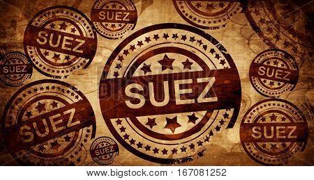 suez, vintage stamp on paper background