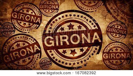 Girona, vintage stamp on paper background