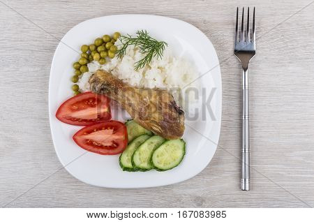 Fried Legs With Vegetable And Rice In Glass Plate